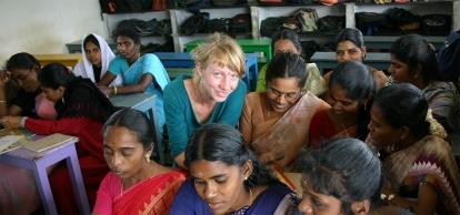 Local women sit in on an English lesson in India